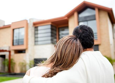 Loving couple looking at their dream house.jpeg